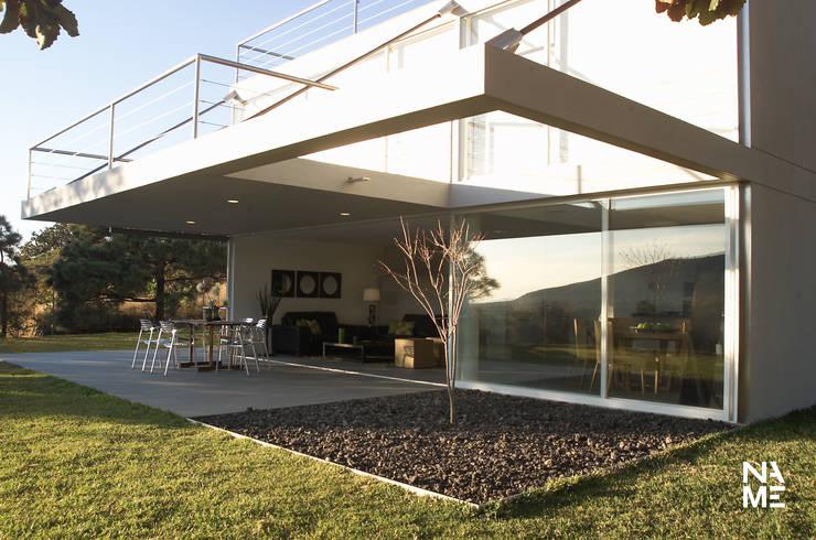 CASA BS: Jardines de estilo  por NAME Arquitectos