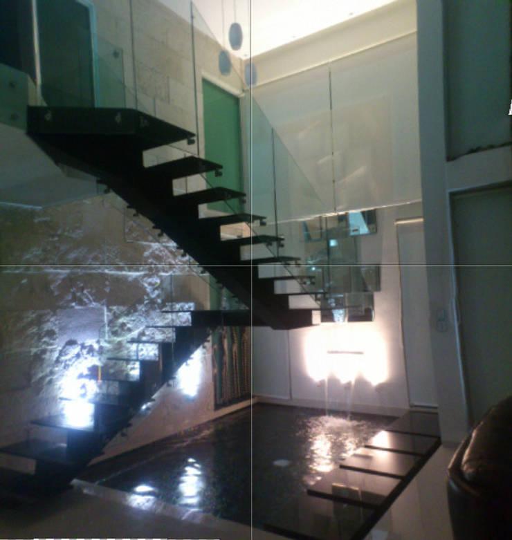 CASA BALLENA: Pasillos y recibidores de estilo  por Diseño Aplicado Avanzado de Guadalajara
