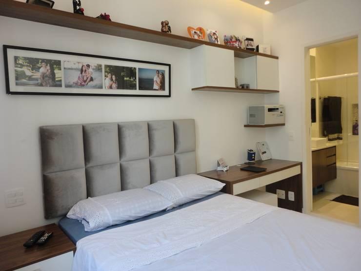 Quarto do casal - suite: Quartos  por Maria Helena Torres Arquitetura e Design