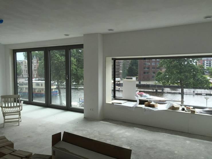 Nieuwbouw appartementen:  Woonkamer door MSW Bouwadvies
