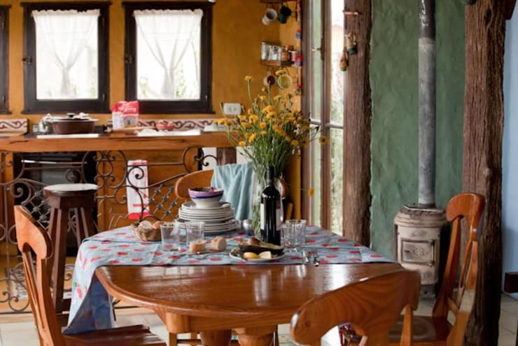 Casa Claudia Carboni: Comedores de estilo  por Susana Bellotti Arquitectos