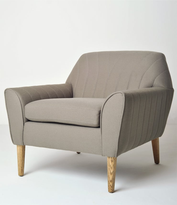 Vintage Chair:  Living room by www.mezzanineinteriors.co.za