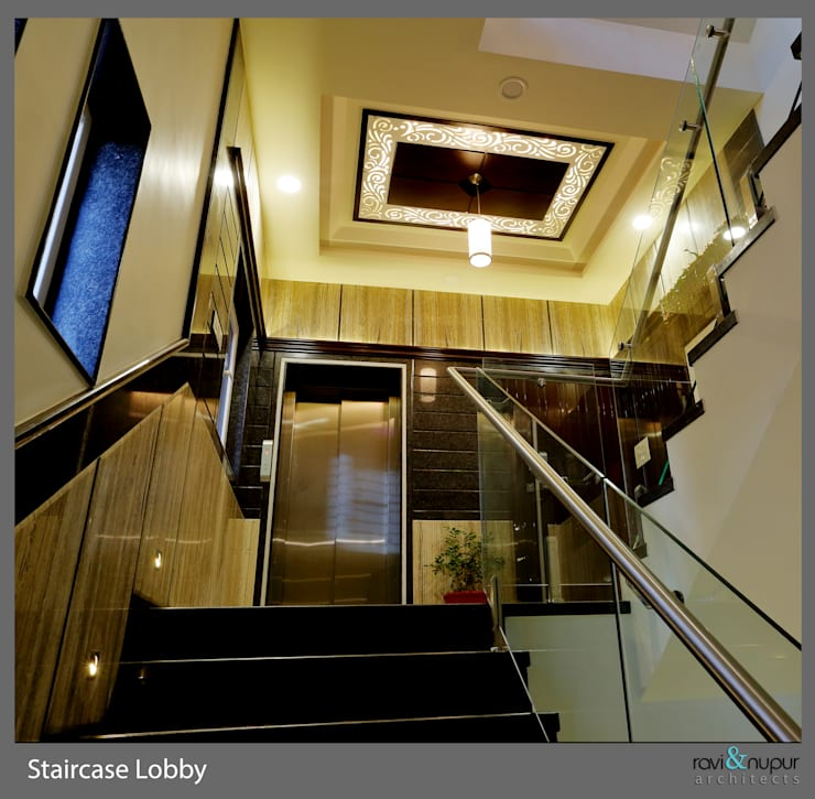 Staircase Lobby:  Corridor & hallway by RAVI - NUPUR ARCHITECTS,Modern