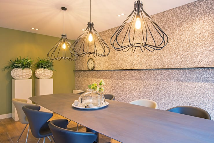 Salas / recibidores de estilo  por HomeAccent Interieurbureau, Moderno Ladrillos