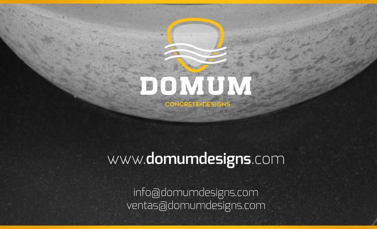 CONTACTO: Baños de estilo  por Domum