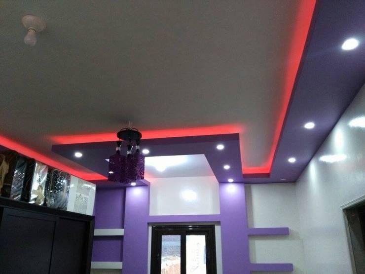 تشطيب شقة بالتجمع الخامس بالقاهرة الجديدة :  غرفة نوم تنفيذ كاسل للإستشارات الهندسية وأعمال الديكور في القاهرة, كلاسيكي