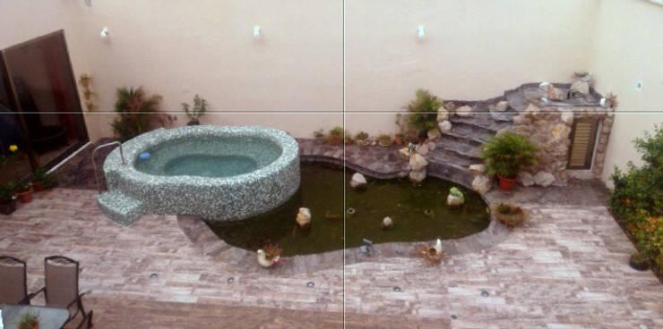 jacuzzi-espejo-cascada: Albercas de estilo  por Diseño Aplicado Avanzado de Guadalajara