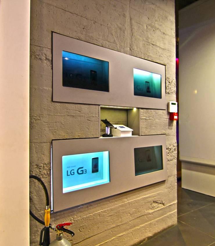 Doğancı Dış Ticaret Ltd. Şti. – Türkiye genelindeki Turkcell mağazalarında yaptığımız beton görünümlü panel uygulamalarımızdan örnek fotolar..:  tarz Ofisler ve Mağazalar, Endüstriyel