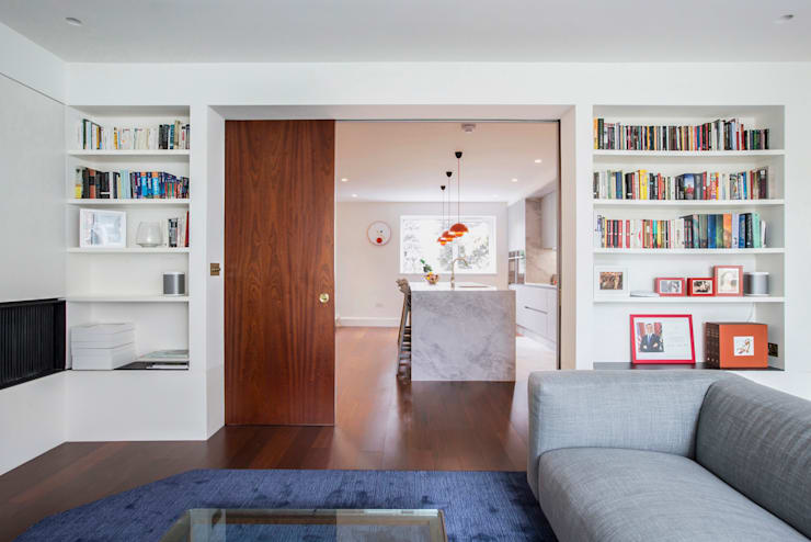 View to kitchen from living room:  Living room by Gundry & Ducker Architecture