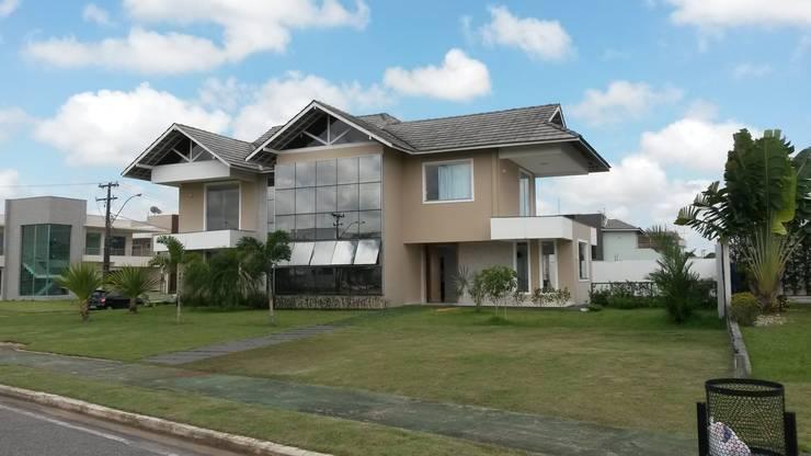 Fachada: Casas modernas por Rmlo Arquitetura . Design . Iluminação