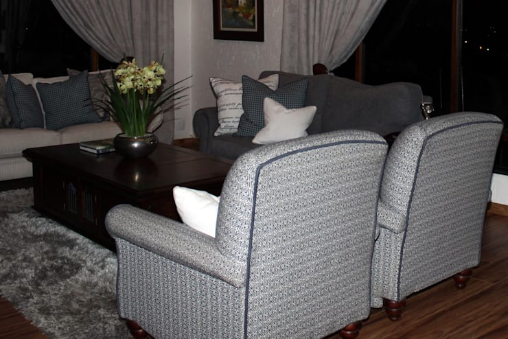 Reupholstered Armchairs:  Living room by Inside Out Interiors