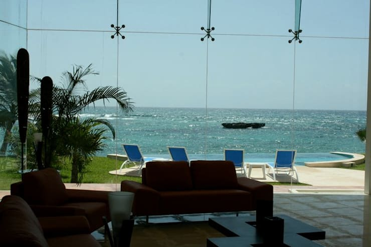 VILLA GAUGUIN: Casas de estilo  por SG Huerta Arquitecto Cancun