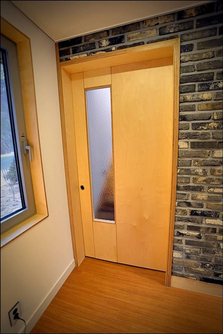 세종시 단독주택: 건축사사무소 사람인의  창문