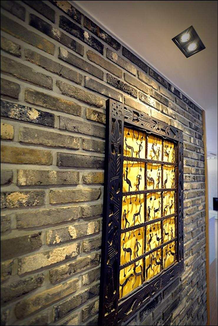 세종시 단독주택: 건축사사무소 사람인의  벽