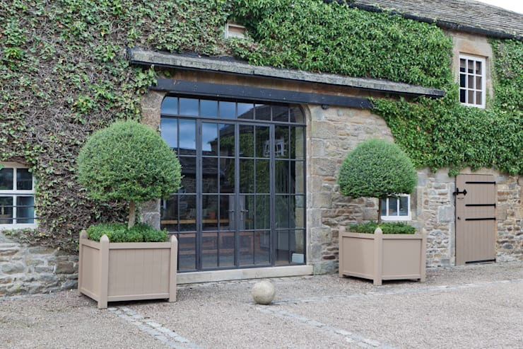 Bronze Screen with Slimline Doors on a Yorkshire Barn Conversion:  Windows & doors  by Architectural Bronze Ltd