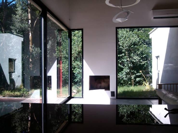 Otra casa, mi otra casa… : Comedores de estilo  por Marcelo Manzán Arquitecto