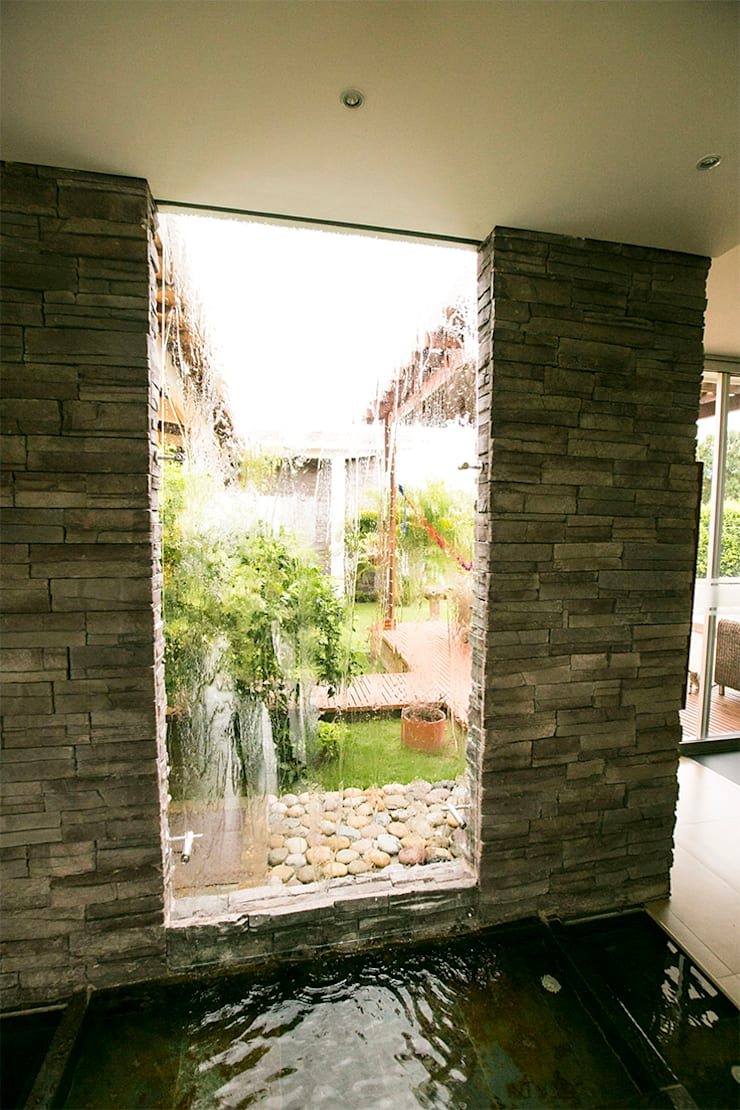 Fuente principal: Jardines de estilo  por Arquitectura Positiva