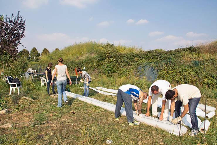 Técnicas de construcción con materiales reciclados : Jardín de estilo  por Arquitectura Positiva