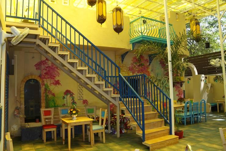 restaurant:  Balconies, verandas & terraces  by Vinyaasa Architecture & Design