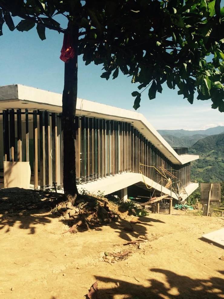 Diseño Rural: Casas de estilo  por COLECTIVO 720