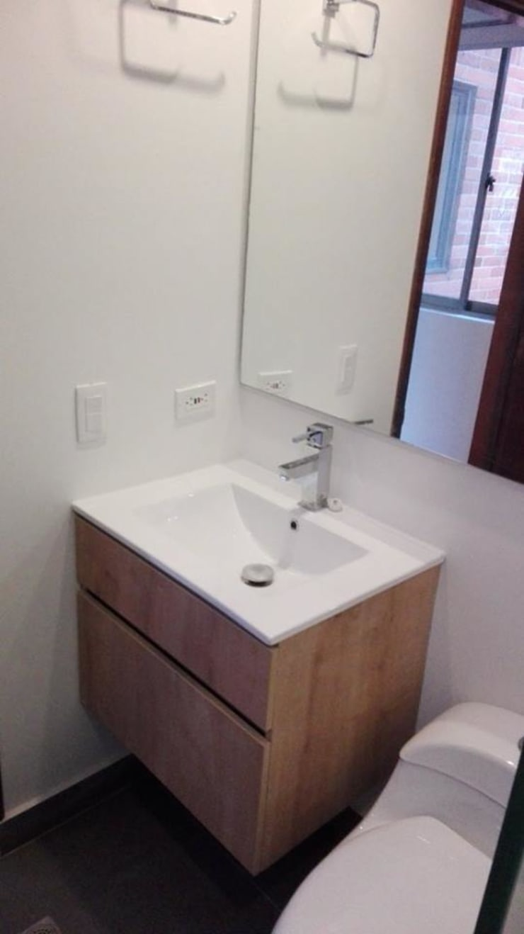 Apartamento en Bogota: Baños de estilo  por estudio unouno, Moderno