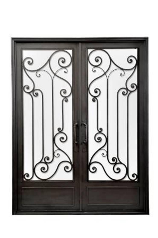Puerta de entrada de hierro forjado: Casas de estilo  por DEL HIERRO DESIGN