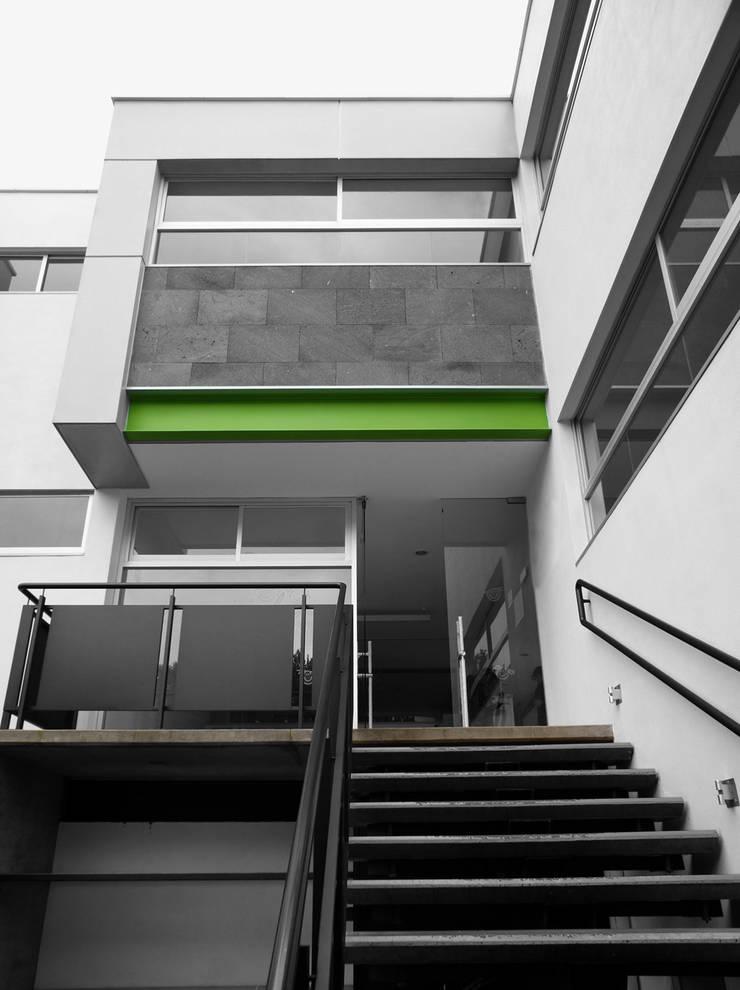 Caziide: Estudios y oficinas de estilo  por Taller Plan A