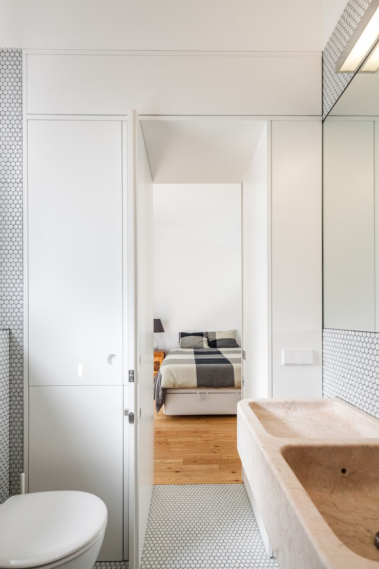 Apartamento AB9: Casas de banho  por FMO ARCHITECTURE