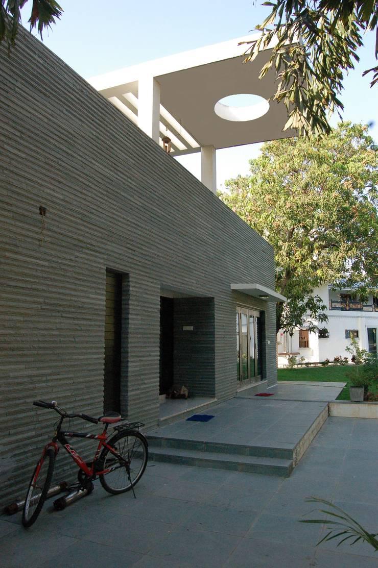 Residence : modern Houses by AM Associates