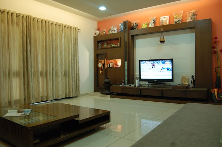 Residence : modern Living room by AM Associates