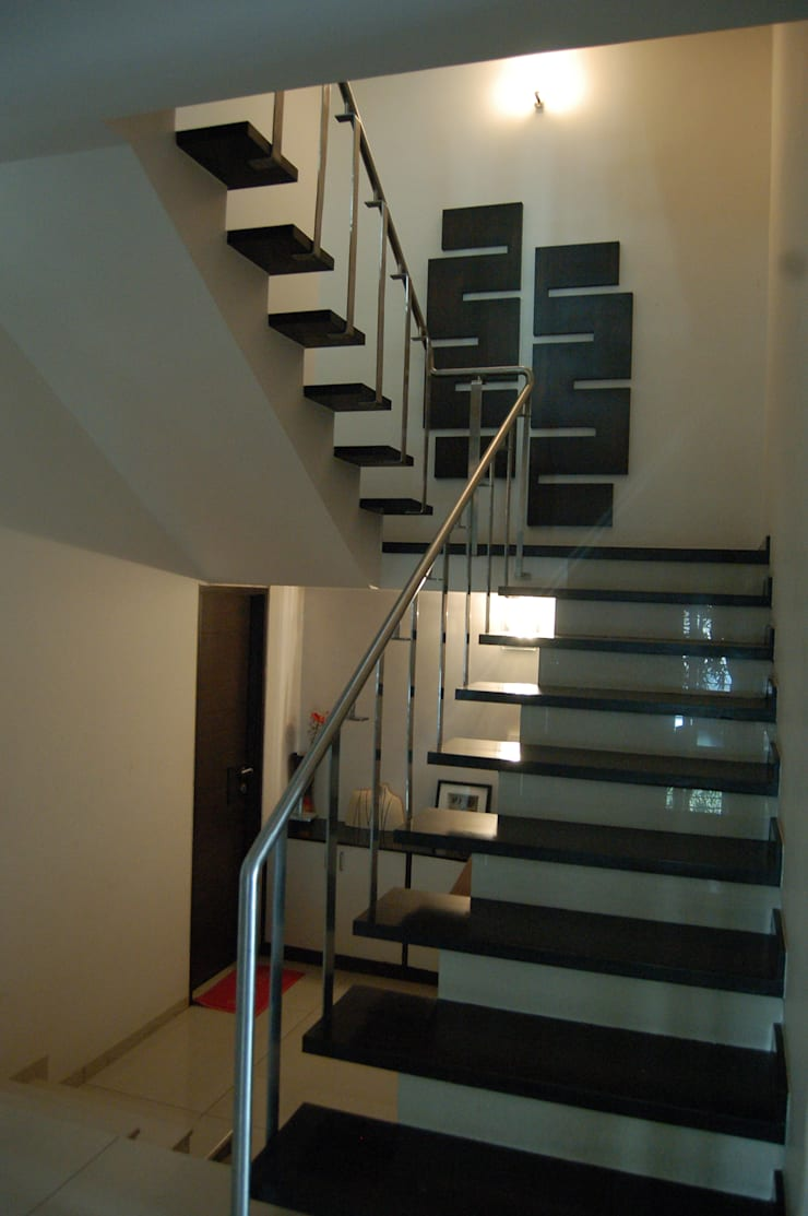 Residence :  Corridor & hallway by AM Associates