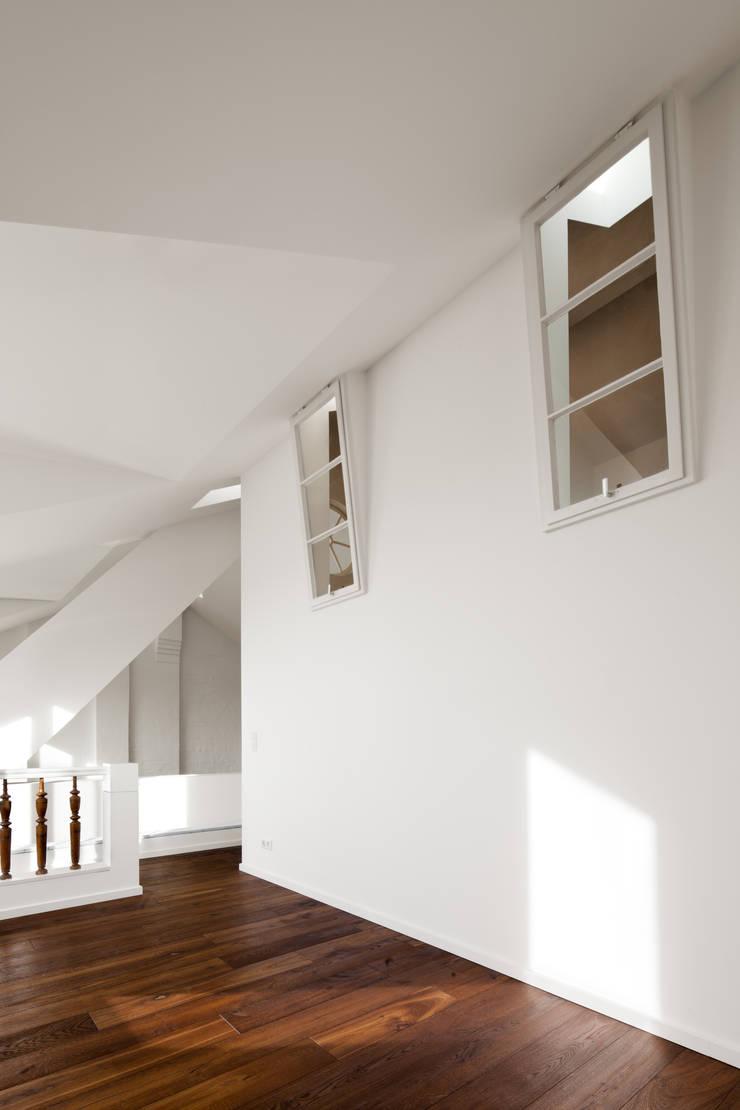 inside windows:  Living room by brandt+simon architekten