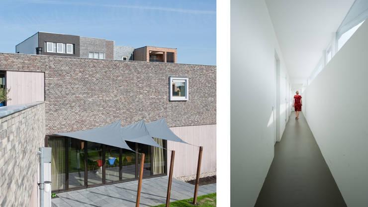 Rijkdom achter een vergrijsde schutting:  Huizen door ARCHITECTUURBUREAU project.DWG, Modern