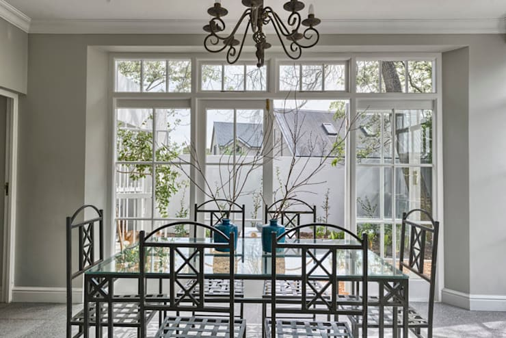 Dining room by House Couture Interior Design Studio