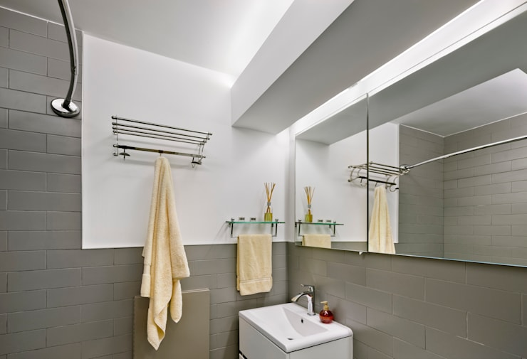Multi generational familty unit: modern Bathroom by Rodriguez Studio Architecture PC