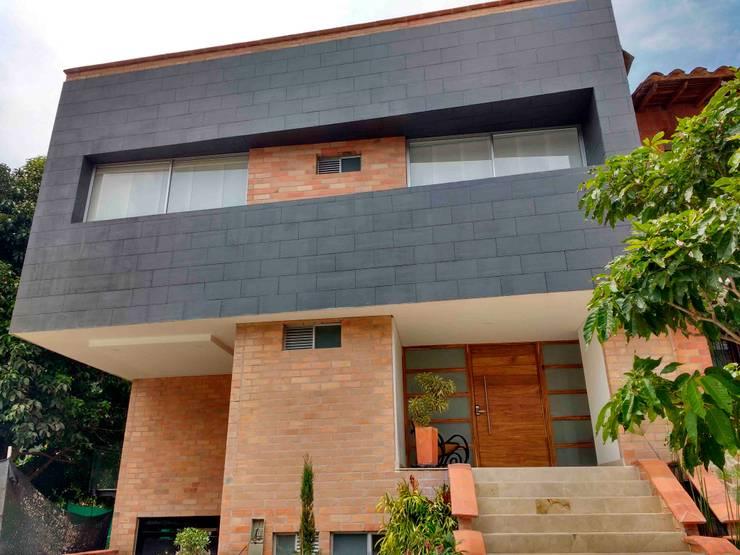 Vivienda unifamiliar-privada: Casas de estilo  por Le.tengo Arquitectos, Moderno