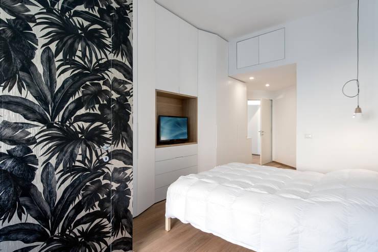 Dormitorios de estilo  por Tommaso Giunchi Architect
