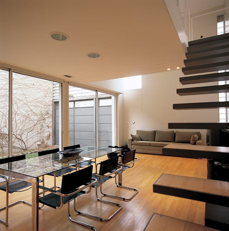 Casa Ocampo: Salas de estilo  por costa & valenzuela