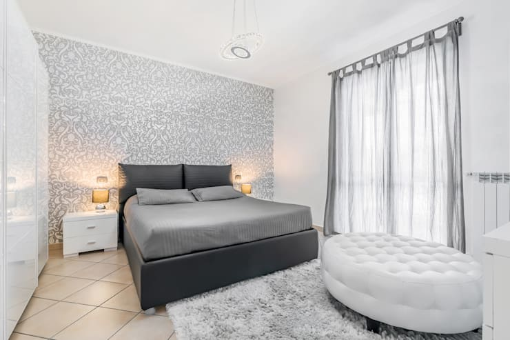 Colore grigio perla in camera da letto. Camera da letto  Camera da letto in stile  di Facile Ristrutturare 1abe10b7a9f8