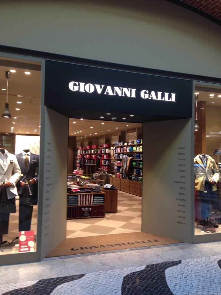 Loja Giovanni Galli: Lojas e espaços comerciais  por mube arquitectura