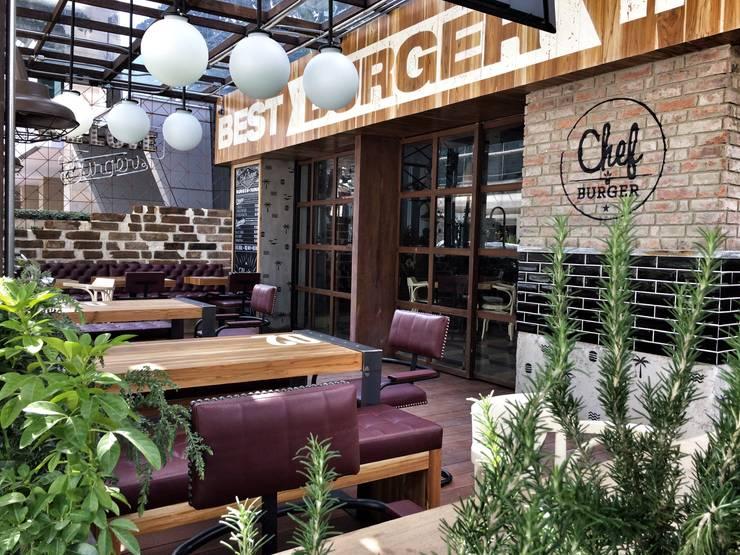 CHEF BURGER: Locales gastronómicos de estilo  por FABIAN PEREZ ARQUITECTO, Ecléctico Madera Acabado en madera