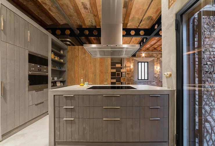 Cozinhas rústicas por N.A. Construcción