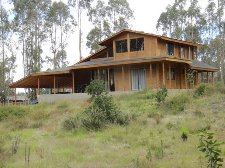 Casas de estilo rústico por Proyecto ARQ
