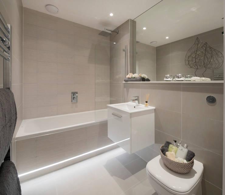 Baños de estilo  por Jigsaw Interior Architecture