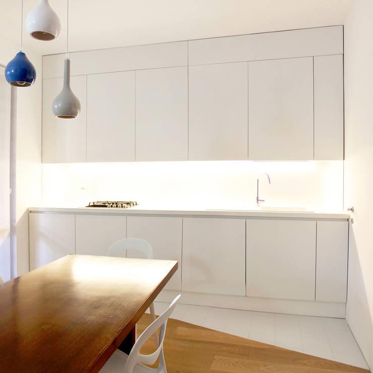 CASA S. GROSSETO: Cucina in stile  di OKS ARCHITETTI, Minimalista