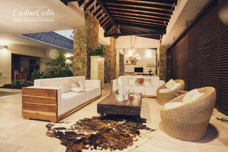 Salas/Recibidores de estilo  por Cristina Cortés Diseño y Decoración