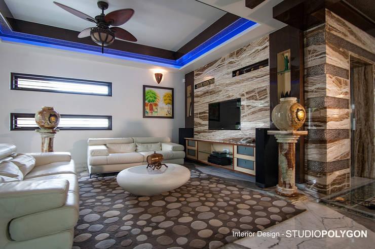 Living room:  Living room by Studio Polygon