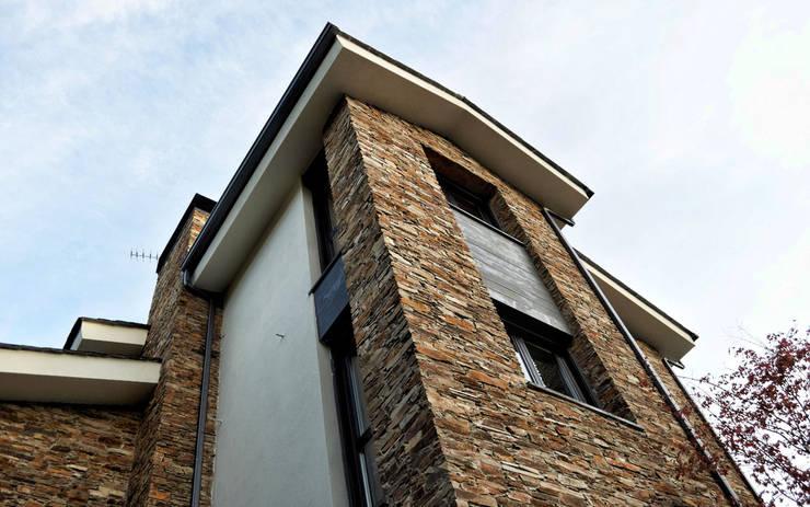 Maisons de style  par Intra Arquitectos, Moderne
