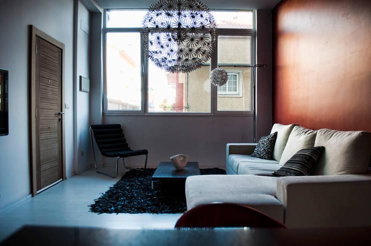 Salon de style  par Intra Arquitectos, Moderne
