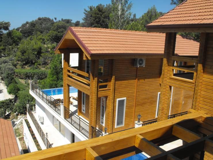 SAYTAS SABUNCUOGLU YAPI VE TIC.LTD.STI. – KALKAN Wooden Houses:  tarz , Kırsal/Country